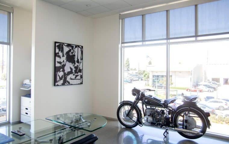 car dealership art, art with motorcycle in frame