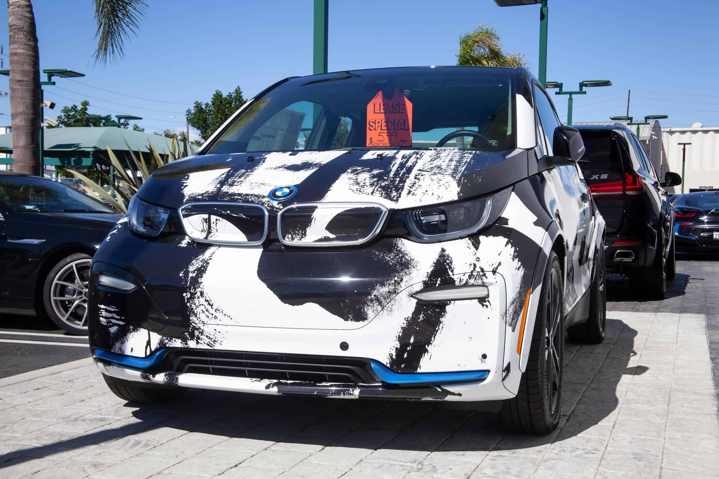 abstract art car wrap, car dealership art